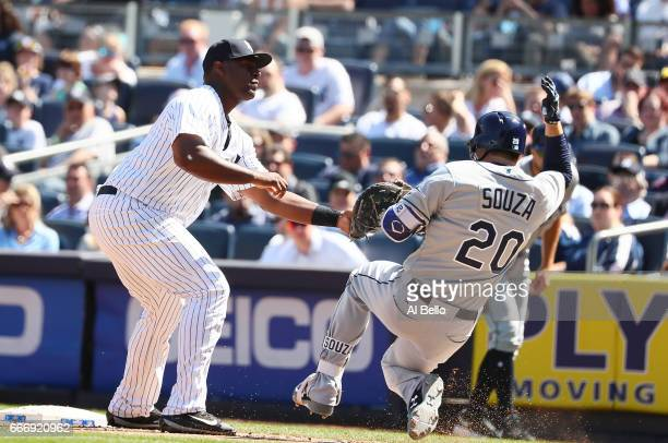 Chris Carter of the New York Yankees tags out Steven Souza Jr #20 of the Tampa Bay Rays at first base during the New York Yankees home Opening game...