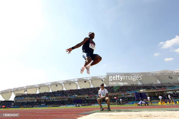 Chris Carter of the United States competes in the men's triple jump final during Day 13 of the XVI Pan American Games at Telmex Athletics Stadium on...