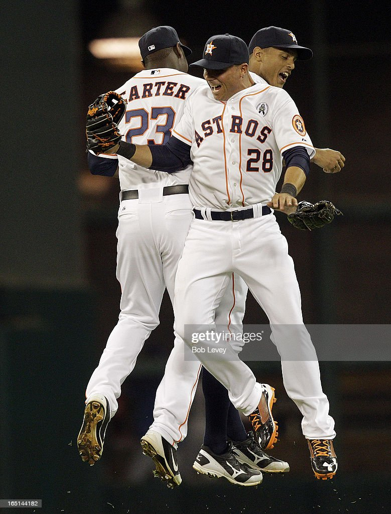 Chris Carter #23, Rick Ankiel #28 and Justin Maxwell #44 of the Houston Astros celebrate after the final out against the Texas Rangers at Minute Maid Park on March 31, 2013 in Houston, Texas.