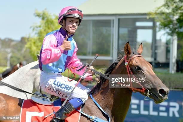 Chris Caserta returns to the mounting yard on Elegant Queen after winning the Ron Hutchinson Turns 90 Hcp at Mornington Racecourse on December 13...