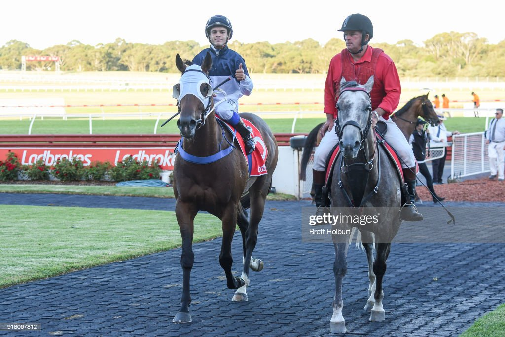 Chris Caserta returns to the mounting yard on Heptagon (NZ) after winning the Ladbrokes Handicap at Ladbrokes Park Lakeside Racecourse on February 14, 2018 in Springvale, Australia.