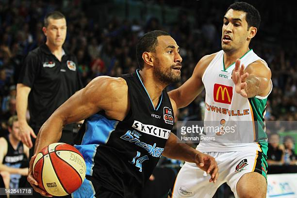 Chris Cedar of the Crocodiles defends against Mika Vukona of the Breakers during game three of the NBL Finals series between the Townsville...