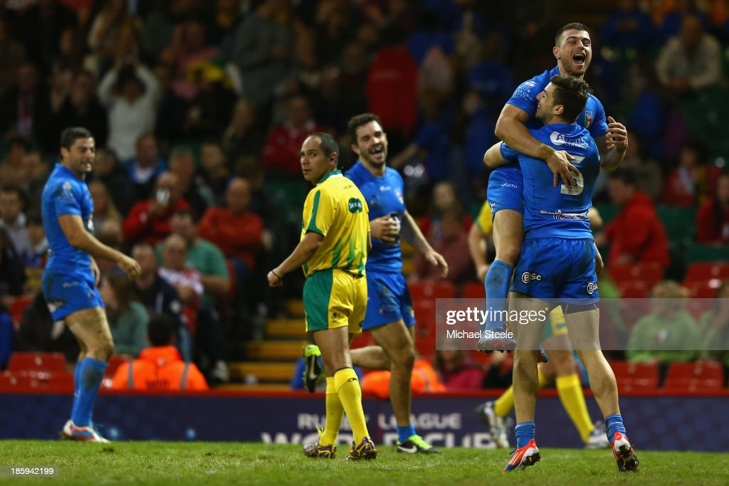 Chris Centrone (#5) of Italy celebrates scoring a try with Ben Falcone during the Rugby League World Cup Inter group match between Wales and Italy at the Millennium Stadium on October 26, 2013 in Cardiff, Wales.