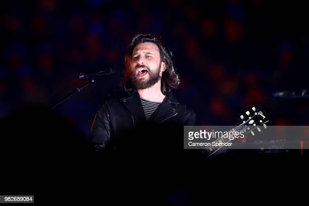 Chris Cester and his band JET perform during game two of the State of Origin series between the New South Wales Blues and the Queensland Maroons at...