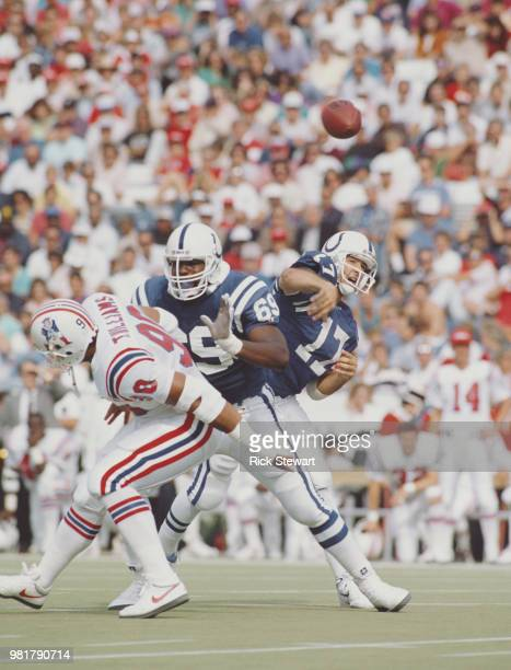Chris Chandler Quarterback for the Indianapolis Colts throws to pass as Patriots Guard Randy Dixon blocks Toby Williams the Indianapolis Colts...