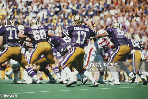 Chris Chandler, Quarterback for the University of Washington Huskies prepares to throw the ball during the NCAA Pac-10 Conference college football...