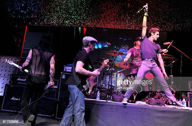 Chris Chaney Matt Sorum and Perry Farrell performs at The Surfrider Foundation's 25th Anniversary Gala at the California Science Center's Wallis...