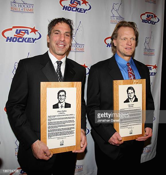 Chris Chelios and Gary Suter pose with their plaques during a media availability before the 2011 US Hockey Hall of Fame Induction at the Renaissance...