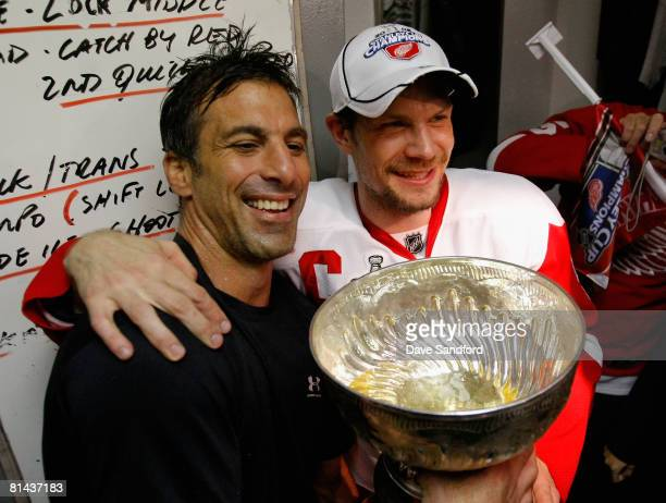 Chris Chelios and Nicklas Lidstrom of the Detroit Red Wings celebrate with the Stanley Cup in the locker room after defeating the Pittsburgh Penguins...
