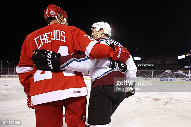 Chris Chelios of the Detroit Red Wings and Joe Sakic of the Colorado Avalanche skate across the ice during the 2016 Coors Light Stadium Series Alumni...