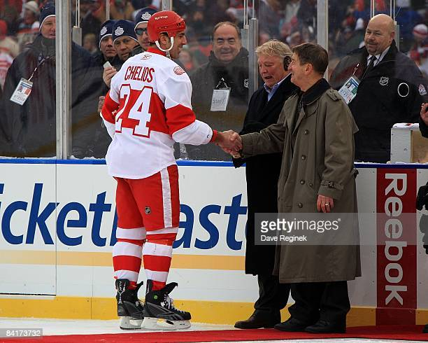 Chris Chelios of the Detroit Red Wings greets former Wing great Ted Lindsay and former Hawks great Bobby Hull before the NHL Winter Classic game...