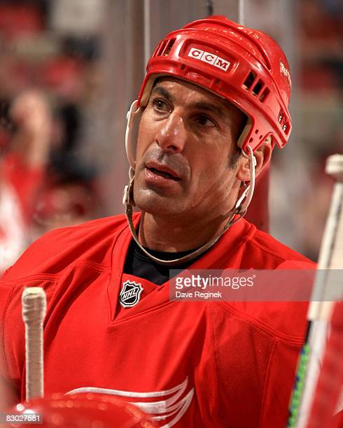 Chris Chelios of the Detroit Red Wings looks towards the coach on the bench during the NHL preseason opener against the Montreal Canadiens on...