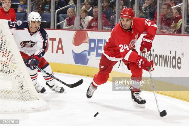Chris Chelios of the Detroit Red Wings passes the puck before Manny Malhotra of the Columbus Blue Jackets can defend on November 18, 2007 at...
