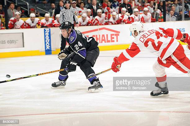Chris Chelios of the Detroit Red Wings reaches in to stop the puck against Alexander Frolov of the Los Angeles Kings during the game at Staples...