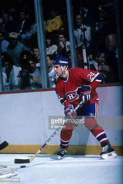 Chris Chelios of the Montreal Canadiens holds the puck behind the net during Game 1 of the 1987 Eastern Conference Finals against the Philadelphia...