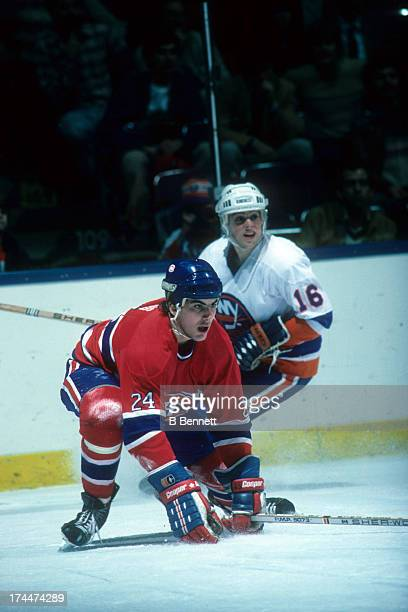 Chris Chelios of the Montreal Canadiens looks to block a shot as Pat LaFontaine of the New York Islanders looks on during their game on January 30,...