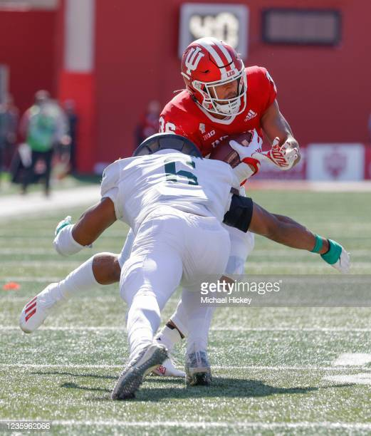 Chris Childers of the Indiana Hoosiers runs into the tackle of Michael Fletcher of the Michigan State Spartans during the game at Indiana University...