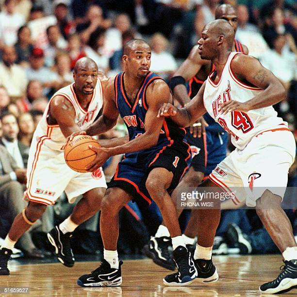 79f8a52c691 Chris Childs of the New York Knicks handles the ball while under pressure  from Jamal Mashburn