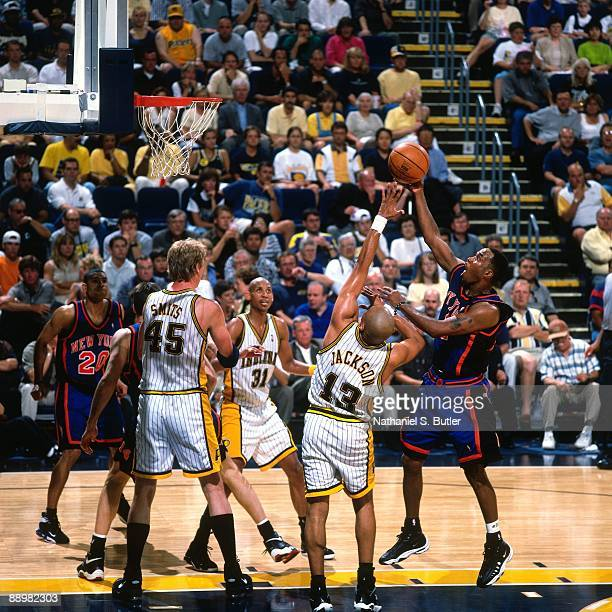 Chris Childs of the New York Knicks shoots a layup against Mark Jackson of the Indiana Pacers in Game Five of the Eastern Conference Finals during...