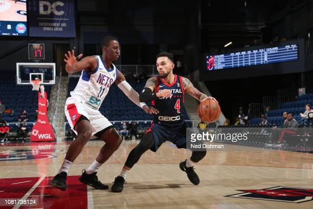 Chris Chiozza of the Capital City GoGo drives against Shannon Scott of the Long Island Nets during an NBA GLeague game at the Entertainment and...