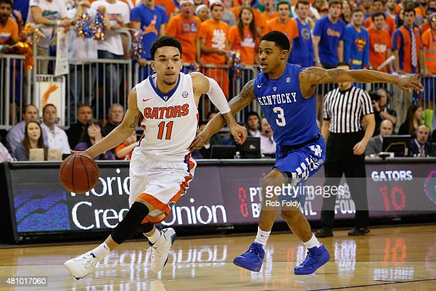 Chris Chiozza of the Florida Gators and Tyler Ulis of the Kentucky Wildcats in action during the game at the Stephen C O'Connell Center on February 7...