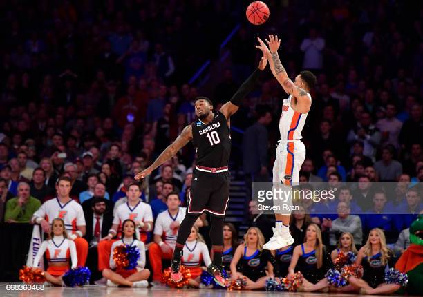 Chris Chiozza of the Florida Gators attempts a shot defended by Duane Notice of the South Carolina Gamecocks during the second half of the 2017 NCAA...