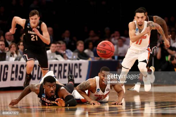 Chris Chiozza of the Florida Gators chases the ball after Duane Notice of the South Carolina Gamecocks and Justin Leon of the Florida Gators lose the...