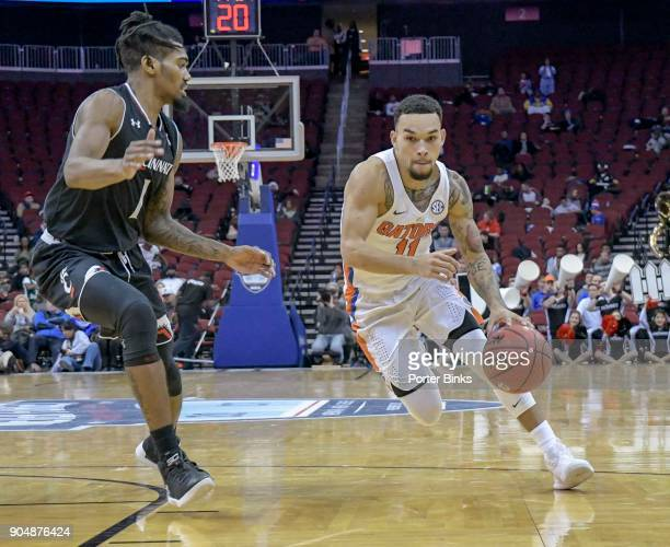 Chris Chiozza of the Florida Gators dribbles the ball against the Cincinnati Bearcats in the Never Forget Tribute Classic at the Prudential Center on...