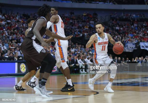 Chris Chiozza of the Florida Gators dribbles the ball towards the basket during the NCAA Div I Men's Championship First Round basketball game between...