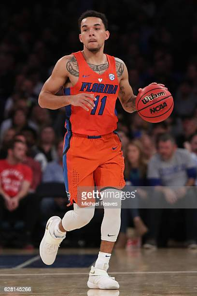 Chris Chiozza of the Florida Gators dribbles up court against the Duke Blue Devils in the first half during the Jimmy V Classic at Madison Square...
