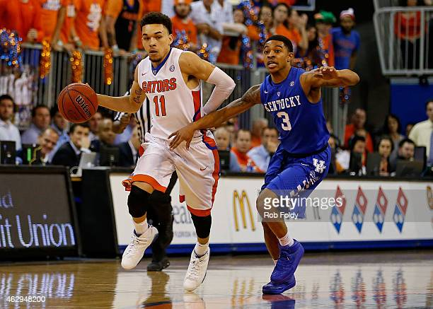 Chris Chiozza of the Florida Gators drives past Tyler Ulis of the Kentucky Wildcats during the first half of the game at Stephen C O'Connell Center...