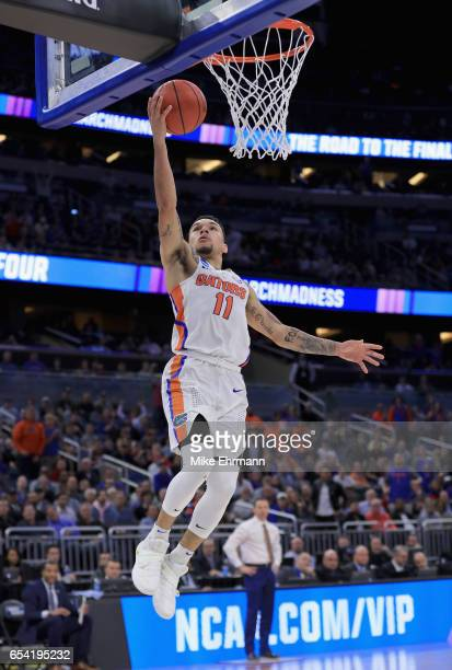 Chris Chiozza of the Florida Gators drives to the basket against the East Tennessee State Buccaneers during the first round of the 2017 NCAA Men's...