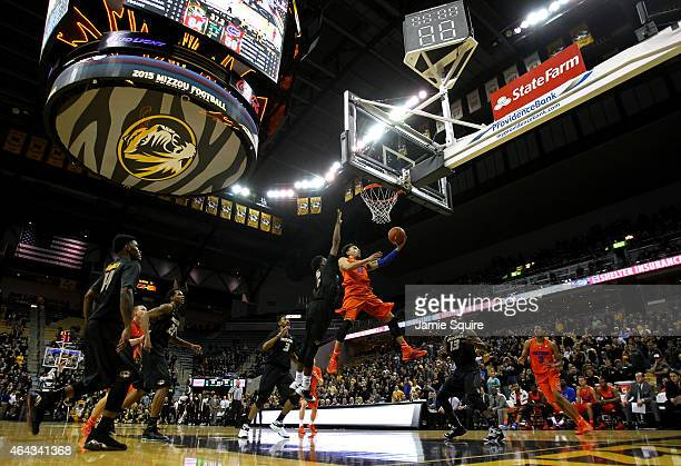 Chris Chiozza of the Florida Gators drives to the basket on a fast break as Namon Wright of the Missouri Tigers defends during the game at Mizzou...