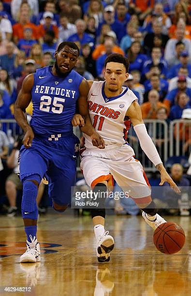 Chris Chiozza of the Florida Gators is defended by Dominique Hawkins of the Kentucky Wildcats during the first half of the game at Stephen C...