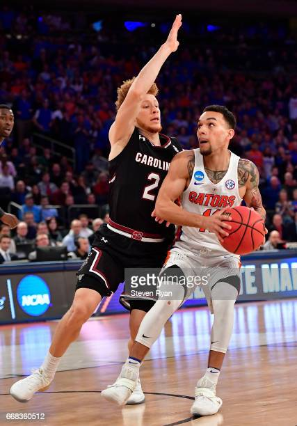 Chris Chiozza of the Florida Gators is defended by Hassani Gravett of the South Carolina Gamecocks during the first half of the 2017 NCAA Men's...