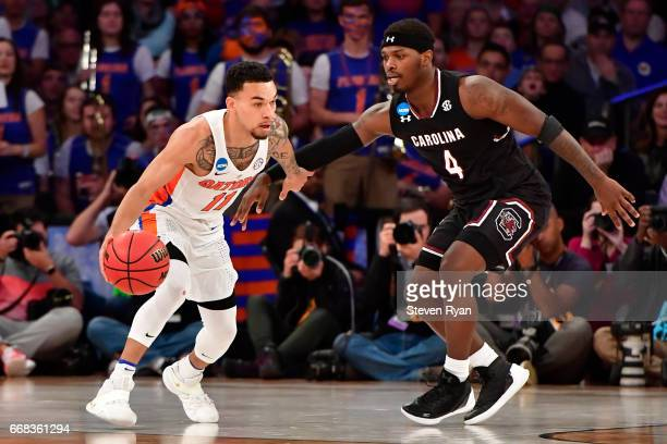 Chris Chiozza of the Florida Gators is defended by Rakym Felder of the South Carolina Gamecocks during the second half of the 2017 NCAA Men's...