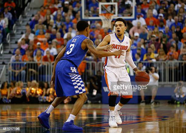 Chris Chiozza of the Florida Gators is defended by Tyler Ulis of the Kentucky Wildcats during the game at the Stephen C O'Connell Center on February...