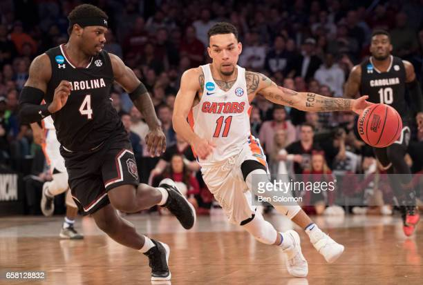 Chris Chiozza of the Florida Gators is guarded by Rakym Felder of the South Carolina Gamecocks during the 2017 NCAA Photos via Getty Images Men's...