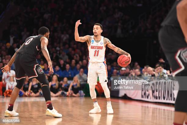 Chris Chiozza of the Florida Gators is guarded Sindarius Thornwell of the South Carolina Gamecocks during the 2017 NCAA Photos via Getty Images Men's...