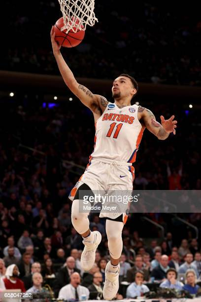 Chris Chiozza of the Florida Gators makes a layup on a break away against the South Carolina Gamecocks in the second half during the 2017 NCAA Men's...