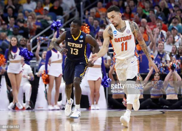 Chris Chiozza of the Florida Gators reacts after basket against AJ Merriweather of the East Tennessee State Buccaneers during the first round of the...