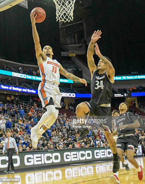 Chris Chiozza of the Florida Gators shoots a layup against the Cincinnati Bearcats in the Never Forget Tribute Classic at the Prudential Center on...
