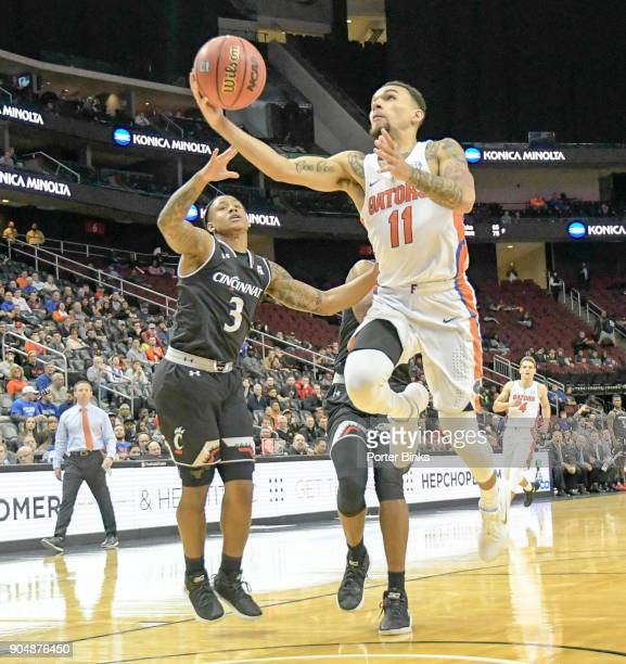 Chris Chiozza of the Florida Gators shoots against the Cincinnati Bearcats in the Never Forget Tribute Classic at the Prudential Center on December 9...