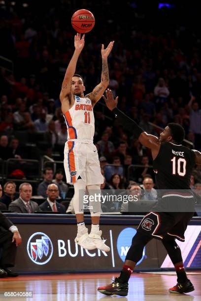 Chris Chiozza of the Florida Gators shoots the ball against Duane Notice of the South Carolina Gamecocks during the 2017 NCAA Men's Basketball...