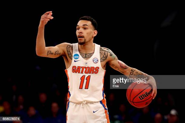 Chris Chiozza of the Florida Gators signals to his teammate against the South Carolina Gamecocks in the first half during the 2017 NCAA Men's...