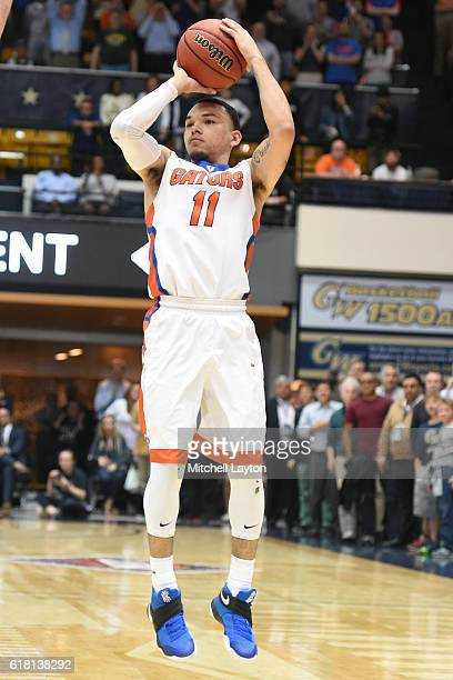Chris Chiozza of the Florida Gators takes a jump shot during the NIT Quarterfinal basketball game against George Washington Colonials at the Smith...