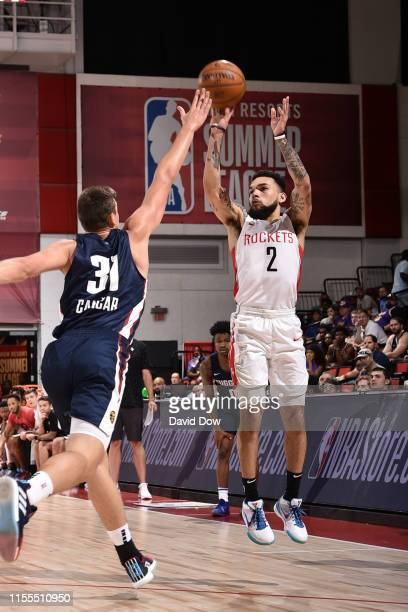Chris Chiozza of the Houston Rockets shoots three point basket against the Denver Nuggets during Day 9 of the 2019 Las Vegas Summer League on July 13...