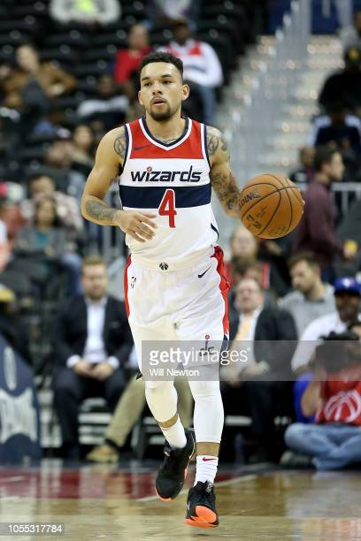 Chris Chiozza of the Washington Wizards dribbles during the second half against the Guangzhou LongLions at Capital One Arena on October 12 2018 in...