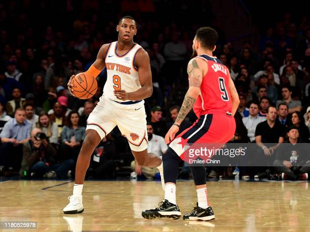 Chris Chiozza of the Washington Wizards guards RJ Barrett of the New York Knicks as he dribbles the ball during their game at Madison Square Garden...