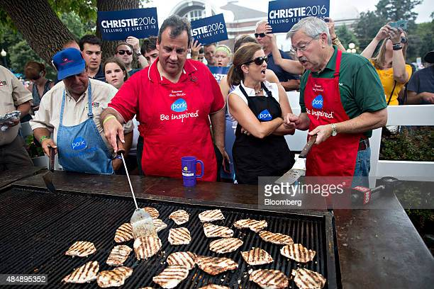 Chris Christie governor of New Jersey and 2016 Republican presidential candidate second from left works the grill at the Iowa Pork Producers tent...